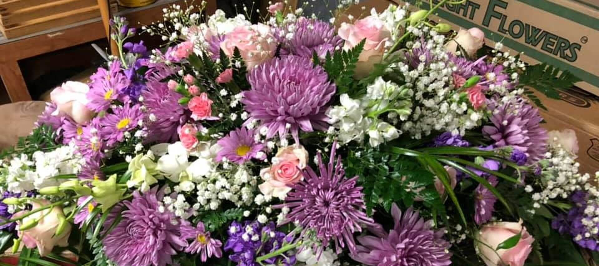 Huge bouquet of white, pink and purple flowers with greenery and baby's breath