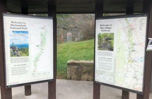 Two large national park signs showing trails and various points of interest